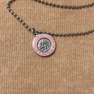 Pink Saint Christopher necklace.